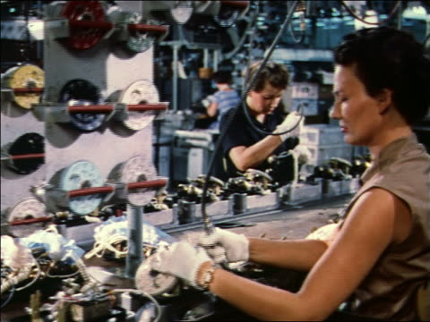 1959 women working on telephones on assembly line - 1950 1959 stock-videos und b-roll-filmmaterial