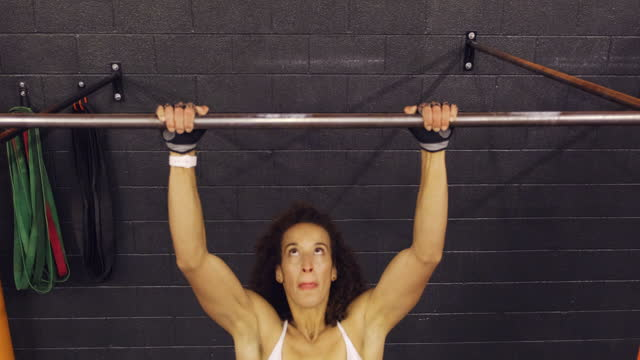 women working out in a gym doing pull-ups - pull ups stock videos & royalty-free footage