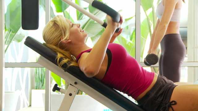women working out lifting weights - braccio umano video stock e b–roll
