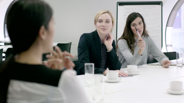 Women Working Together in meeting room