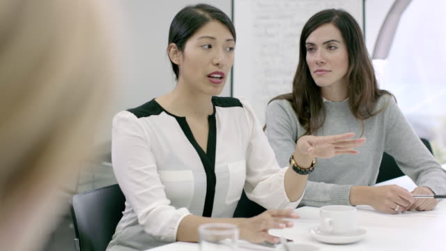 women working together in meeting room - 20 seconds or greater stock videos & royalty-free footage