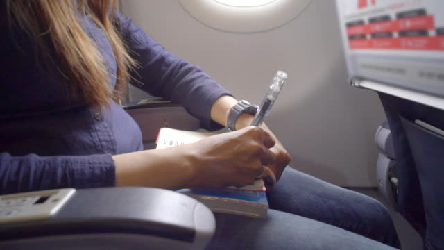 women write diary on airplane - pen stock videos & royalty-free footage
