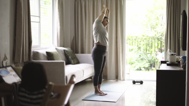 women yoga exercise at home - home workout stock videos & royalty-free footage