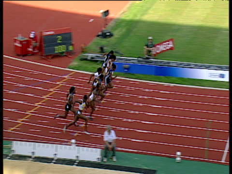 stockvideo's en b-roll-footage met women's 100m competitors on starting blocks veronica campbell explodes from the starting line to win race campbell congratulated by competitors 2004... - sportkampioenschap
