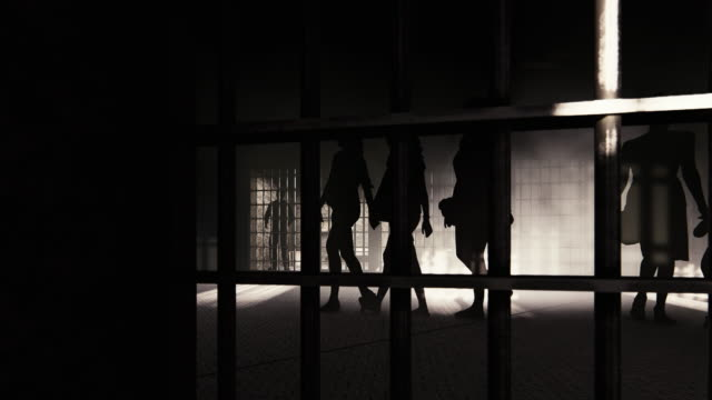 women's and small girl's silhouettes in prison with a prisoner inside his cell - old prisoner stock videos & royalty-free footage
