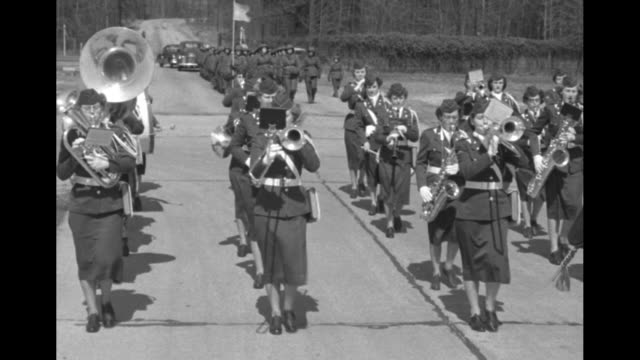 women's army corps band standing in formation ready to march bands begins playing and marching formation of wacs wearing combat gear marching behind... - womens army corps stock videos & royalty-free footage