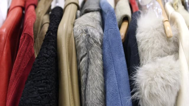 stockvideo's en b-roll-footage met womens clothes and costumes in los angeles, california on march 23rd, 2015 shots: interior wide and close shots of a long rack of colorful female... - witte jurk