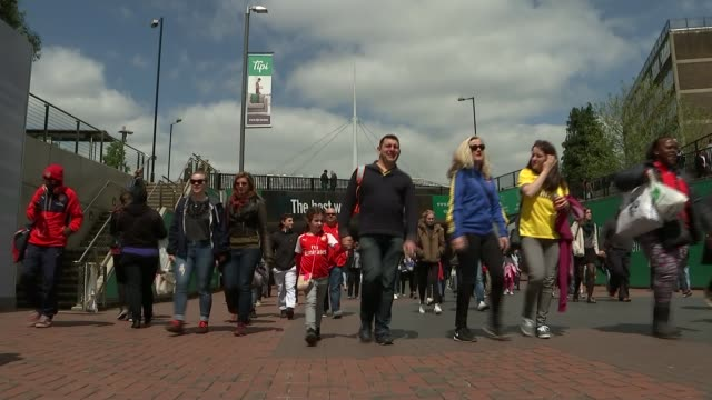 arsenal ladies v chelsea ladies; various shots of fans along wembley way towards stadium ahead of arsenal v chelsea women's fa cup final/ vox pops - final round stock videos & royalty-free footage