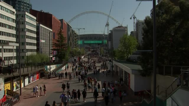 festival of football held at wembley; england: london: wembley: ext crowds towards down steps from wembley park station wide shot wembley stadium and... - final round stock videos & royalty-free footage