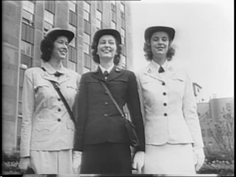 women's fashion during wartime / service women model various military uniforms / women stand in comparison to rockefeller building / women gesture to... - womens army corps stock videos & royalty-free footage