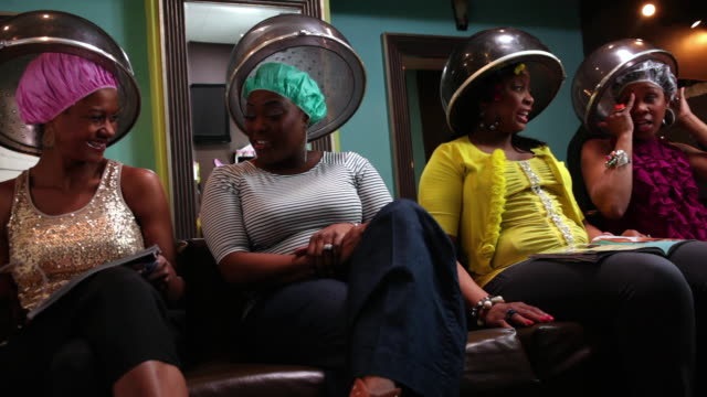 MS Women's getting hair steam in beauty parlor and talking to each other  / Irvington, New Jersey, United States