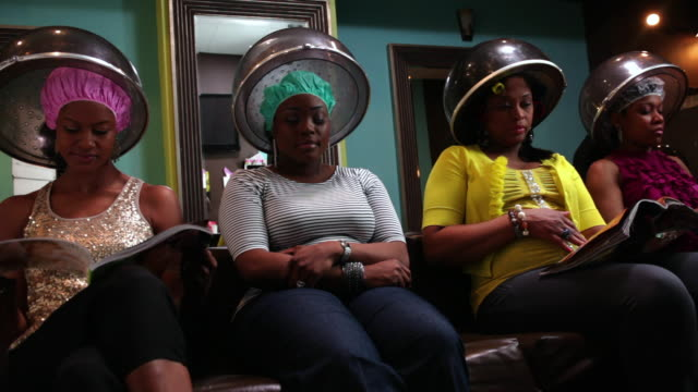 ms women's getting hair steam in beauty parlor / irvington, new jersey, united states - hairdresser stock videos & royalty-free footage