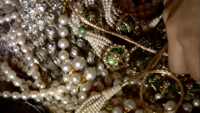 women's hands pick up beautiful jewelry. - pearl jewellery stock videos & royalty-free footage