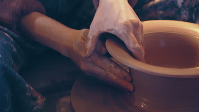 ecu tu women's hands shaping a bowl on a potter's wheel - pottery stock videos & royalty-free footage