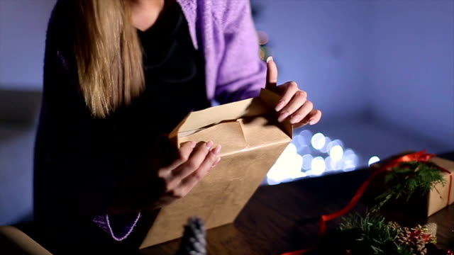 women's hands wrapping christmas gifts at home - wreath stock videos & royalty-free footage
