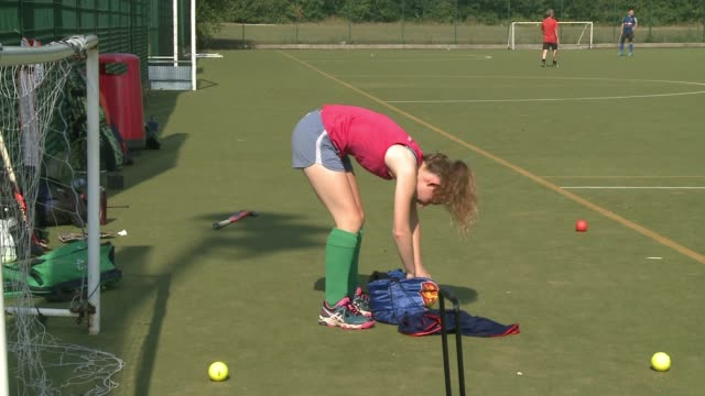 women's hockey world cup starts / london hockey clubs england london waltham forest hockey club ext various of men and women playing hockey sella... - campionato sportivo video stock e b–roll