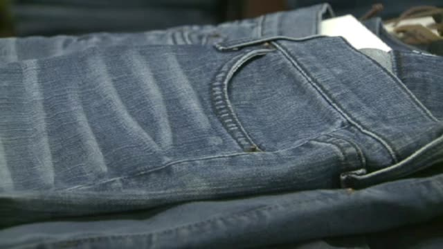 kdaf women's jeans folded in store on july 09 2012 in dallas washington - jeans stock-videos und b-roll-filmmaterial