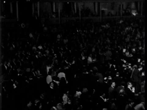 women's liberation movement lib general view albert hall pan stage as demonstration goes on at miss world competiton with things being thrown from... - miss world pageant stock videos & royalty-free footage