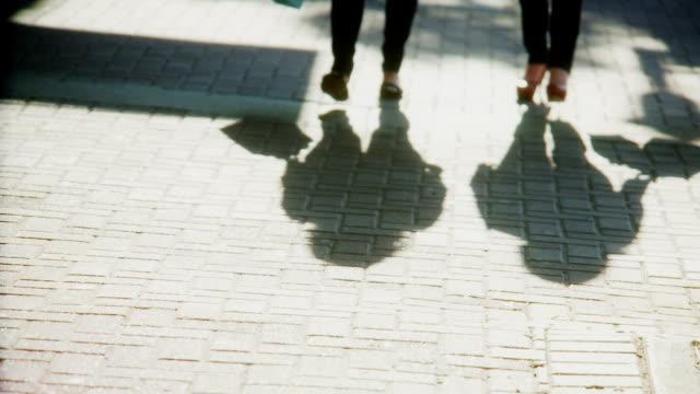 womens lower body and shopping bags - kullersten bildbanksvideor och videomaterial från bakom kulisserna