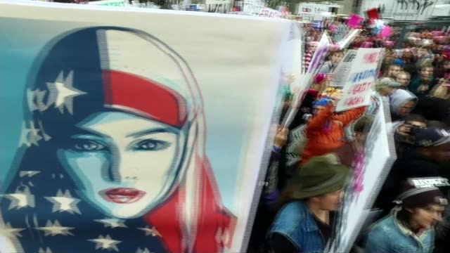 vídeos de stock e filmes b-roll de women's march / donald trump visits cia usa washington dc ext close shot protest placard with 'we the people' art by shepard fairey wide shot capitol... - chapéu