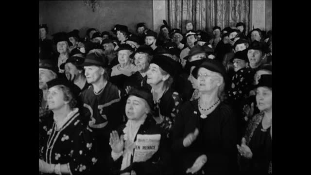 temperance women's meeting speaker happily reporting on cities amp towns that voted themselves 'dry' women standing singing temperance union focusing... - 1937 stock videos and b-roll footage