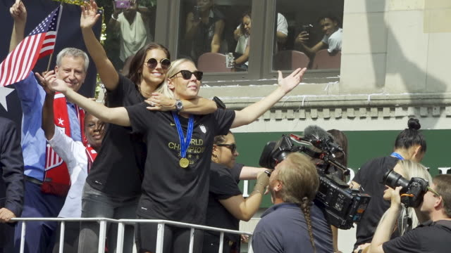 women's national team signs autographs before the start of the parade from battery park via broadway onto city hall in manhattan, new york city. the... - fifa stock videos & royalty-free footage