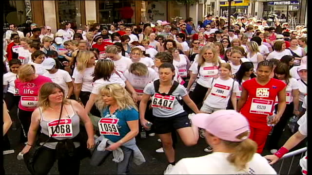 women's race to raise millions for cancer research charity; england: london: ext women running along during race for cancer research's 'race for... - gloria hunniford stock videos & royalty-free footage