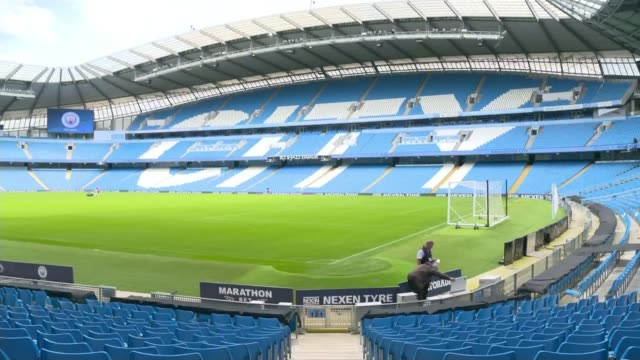 women's super league to kick off with record crowd; england: manchester: etihad stadium: int manchester city logo on big screen groundskeepers... - football pitch stock videos & royalty-free footage