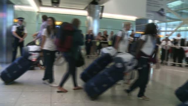 Women's World Cup 2015 England team return home ENGLAND London Heathrow Airport INT England women footballers along through airport with their...