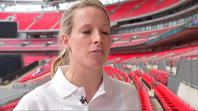 Women's World Cup 2015 Preparations for England v France match ENGLAND London Wembley EXT Various shots Rachel BrownFinnis speaking to reporter...