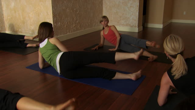 a women's yoga class - see other clips from this shoot 1149 stock videos & royalty-free footage