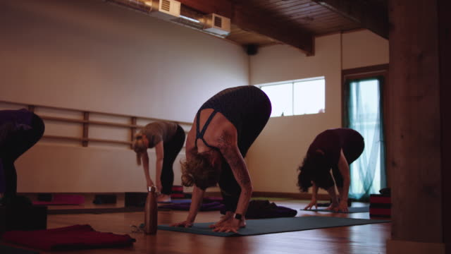 slo mo women's yoga studio - fatcamera stock videos & royalty-free footage