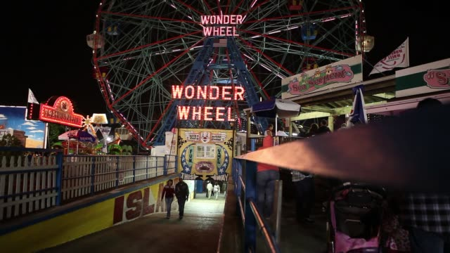 wide shot - wonder wheel ride at coney island, brooklyn, ny usa - coney island stock-videos und b-roll-filmmaterial