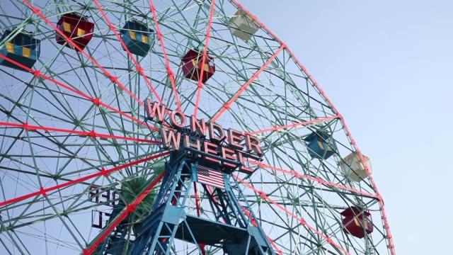 wide shot - wonder wheel ride at coney island, brooklyn, ny usa - coney island stock videos and b-roll footage