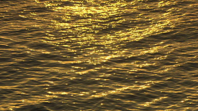 vídeos de stock, filmes e b-roll de wondrous golden sunlight sparkles on the calm tyrrhenian sea during sunrise. - lugar genérico