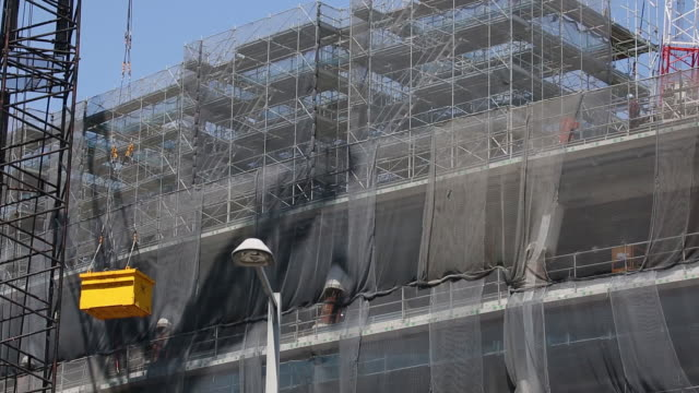 wood and steel composite frames to be used for the roof of the new national stadium a venue for 2020 summer olympics and paralympics in tokyo japan... - 建設作業員点の映像素材/bロール