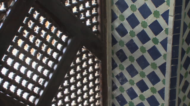CU TU Wood and tile motifs in riad, Fez, Morocco