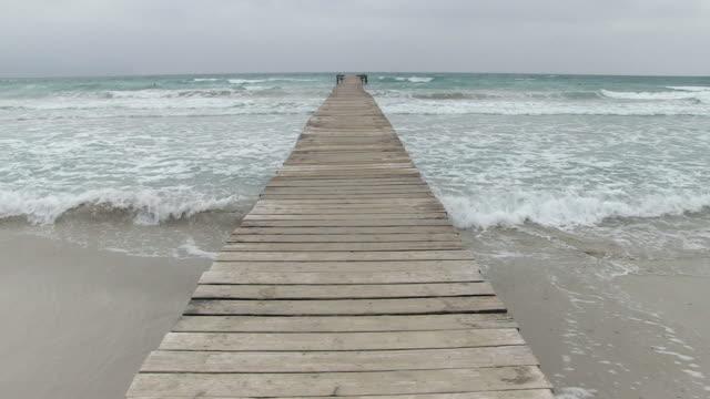 WS Wood bridge in beach  / Alcudia, Mallorco Baleric Island, Spain