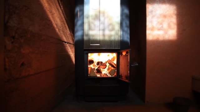 wood burning in sauna stove - sauna stock videos and b-roll footage