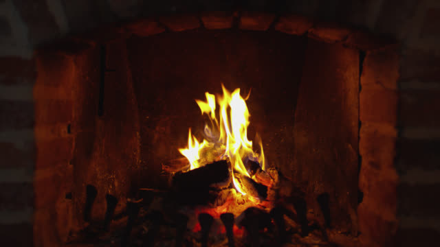 zi wood burning in the fireplace - open fire stock videos & royalty-free footage