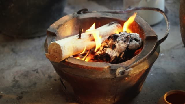 wood burning in the thai traditional stove - log stock videos & royalty-free footage