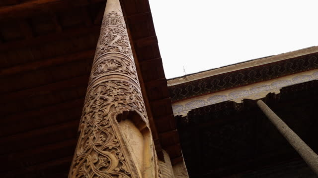 wood carved pillar in a temple in uzbekistan - wood material stock videos & royalty-free footage