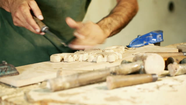wood carving master works - close up video shooting - one mid adult man only stock videos & royalty-free footage