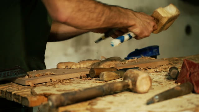 wood carving master works - close up video shooting - arto umano video stock e b–roll
