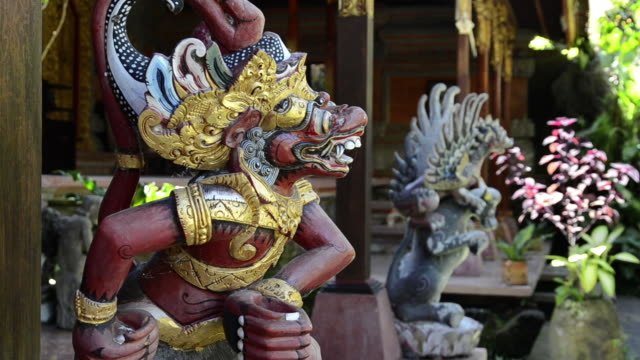 ms wood carving temple guardian in front of palace puri saren / ubud, bali, indonesia - ubud district stock videos & royalty-free footage