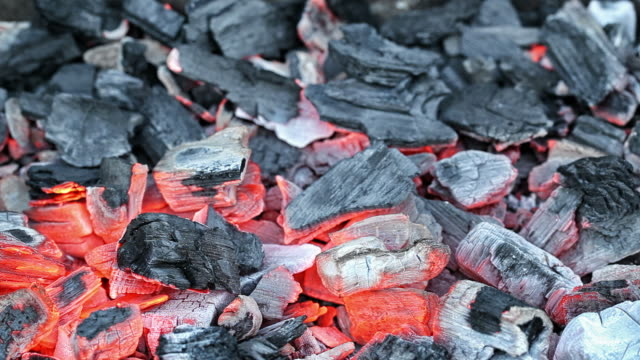 wood charcoal burning on a grill - coal stock videos & royalty-free footage