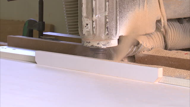 wood cutting machine in a furniture factory - sawdust stock videos and b-roll footage