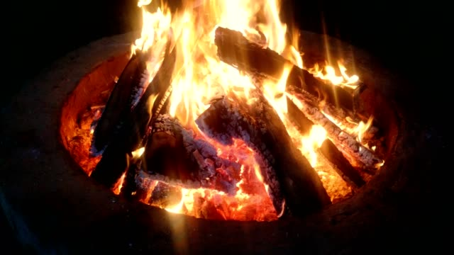 wood fire in a pit at night. - wood material stock videos & royalty-free footage