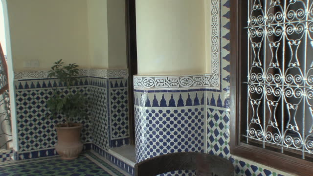 MS TD Wood, metal and tile motifs in riad, Fez, Morocco
