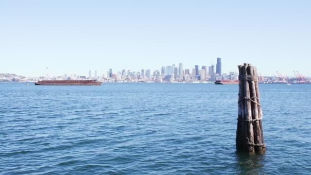 Wood pilings look over Seattle skyline, wide